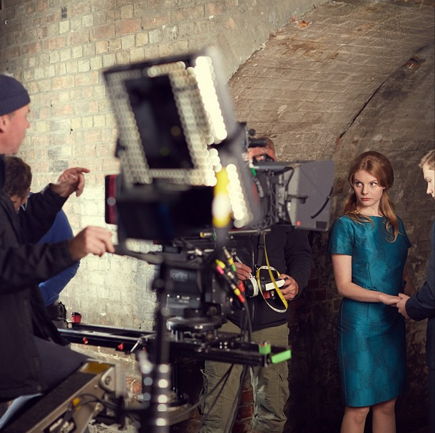 The cast and crew working together to shoot a scene under a bridge, a location that we don't normally associate with #CalltheMidwife! #bbcone #BTS #behindthescenes #onset #filming