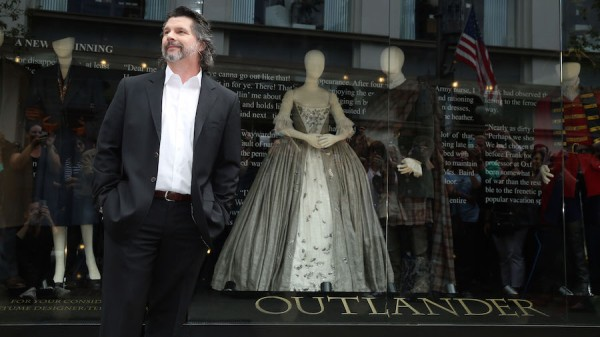 "Showrunner Ronald D. Moore unveils an exhibit of costumes from the first season of the STARZ Original Series ""Outlander"" at The Grove in Los Angeles on Friday, May 22, 2015. (Photo by Matt Sayles/Invision for STARZ/AP Images)"